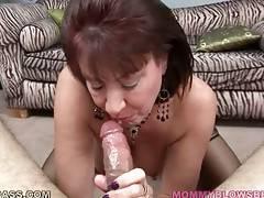 Older hooker enjoys the taste of partner`s erect cock.